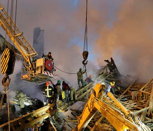 Iranian firefighters remove debris of the Plasco building which was engulfed by a fire and collapsed on Thursday, in central Tehran, Iran, Friday, Jan. 20, 2017. (AP Photo/Ebrahim Noroozi)