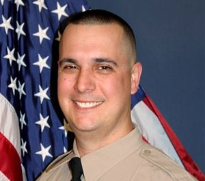 Deputy Brian Ishmael was fatally shot while responding to a call regarding theft from a private garden. (Photo/AP)