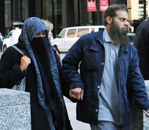 The parents of Mohammed Hamzah Khan, a 19-year-old U.S. citizen from Bolingbrook, Ill., leave the Dirksen federal building Monday, Oct. 6, 2014 in Chicago. (AP Image)