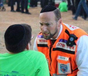 An Israeli EMT in an MCI drill with a special needs patient.