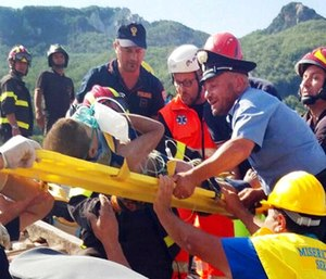 Firefighters and rescuers pull out a boy, Mattias, from the collapsed building in Casamicciola. (Italian Carabinieri, HO/ANSA via AP)
