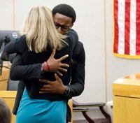 Former Dallas cop convicted of neighbor's murder gets hugs, Bible after trial