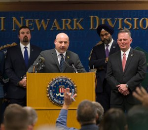 U.S. Attorney Craig Carpenito, center, speaks at a new conference to provide an update on the Dec. 10 Jersey City shootings at the FBI headquarters in Newark, N.J. (Photo/AP)