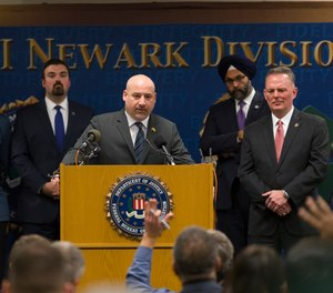 U.S. Attorney Craig Carpenito, center, speaks at a new conference to provide an update on the Dec. 10 Jersey City shootings at the FBI headquarters in Newark, N.J.