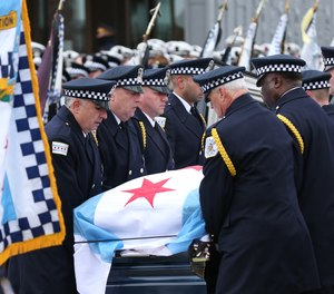 The casket of fallen Chicago Police officer Samuel Jimenez is carried to St. Joseph's Chapel at the Our Lady of Guadalupe Shrine in Des Plaines for the funeral service on Nov. 26, 2018. Jimenez was slain along with two others the previous week at a Near South Side hospital. (Chris Walker/Chicago Tribune/TNS)