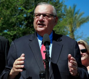 In this May 22, 2018, file photo, former Maricopa County Sheriff Joe Arpaio speaks during a campaign event in Phoenix. Arpaio filed a defamation lawsuit against three news organizations on Monday, Dec. 10, alleging that their inaccurate references to his criminal case have hurt his chances in possibly running in 2020 for the Senate. (AP Photo/Matt York, File)