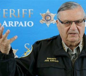 In this Dec. 18, 2013 file photo, Maricopa County Sheriff Joe Arpaio announces dozens of arrests in a prostitution sting during a news conference at Maricopa County Sheriff's Office Headquarters in Phoenix.
