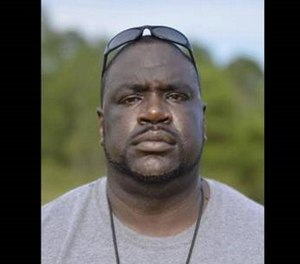 Joseph Foster was hired by the state Department of Corrections in December 2009. (Courtesy photo)