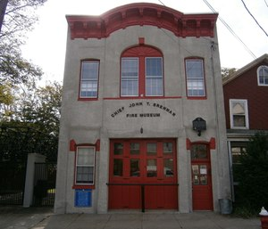 A retired battalion chief was arrested for allegedly stealing John T. Brennan Fire Museum artifacts and selling them.