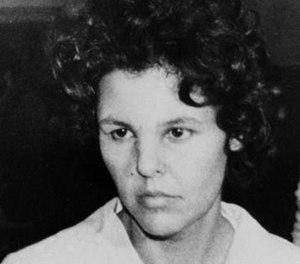 In this Oct. 21, 1981 file photo, Judith Clark is taken into police custody in Nanuet, N.Y. (AP Photo/David Handschuh, File)