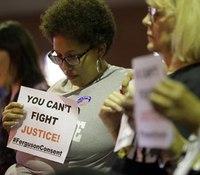 Ferguson City Council votes to accept DOJ police reform deal