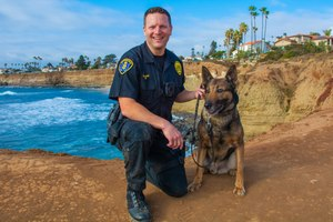 In this photo, Officer Jonathan Wiese is pictured with his K-9. (Photo/Jim Grant)