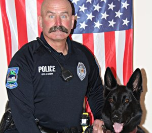 Mason City police officer Duane Kemna and K-9 Kilo pose for a picture.