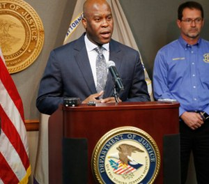 FBI Special Agent in Charge Eric Jackson talks about the agency's role in stopping a bomb plot as he joined Acting U.S. Attorney Tom Beall, left, on Friday, Oct. 14, 2016, in announcing charges in a suspcted domestic terrorism plot, in Wichita, Kan. (Photo/Wichita Eagle)