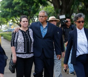 Former deputy prosecutor Katherine Kealoha, center left, and husband, former Honolulu police chief Louis Kealoha, center right, walk toward Queen Street after the verdict in their corruption case at federal court in Honolulu. (Photo/AP)