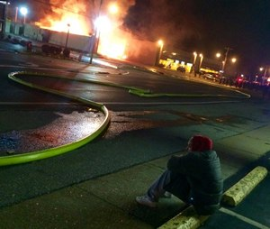 EMS1 video producer Ray Kemp, embedded with fire and EMS, captured this as he and bystanders watched buildings burn in Ferguson, Mo.