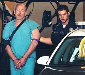 Sandy Police escort suspected kidnapper Troy Morley to a police car for transport to the Salt Lake County Jail, Friday. (AP Image)