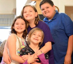 This 2017 photo provided by Torie McCallum shows Sutherland Springs First Baptist Church shooting victims, from left, Megan Hill, Emily Hill, Greg Hill and survivor Evelyn Hill, bottom, in Floresville, Texas. Evelyn survived the Nov. 5 shooting at the church but her brother and sisters along with her mother, who was pregnant, were killed.