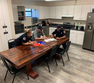 A sense of family is formed around the fire station kitchen table. (Photo/Marc Bashoor)