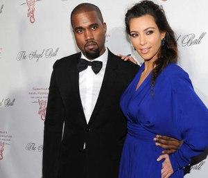 Kim Kardashian and Kanye West are being praised by their neighbors for hiring a private team of firefighters to save their homes. (Photo/AP)