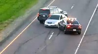 Watch: Driver rams squad cars in wild pursuit across highway
