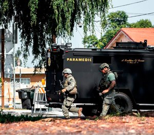 Los Angeles County sheriff's SWAT members get in to position to surround a home where an armed man is barricaded at a property in San Gabriel, Calif. (Watchara Phomicinda/The Press-Enterprise via AP)