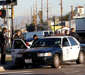 Los Angeles police officers investigate a shooting in South Central Los Angles on Monday, Dec. 29. (AP Image)