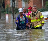 Rains wreak havoc on La.; 3 dead, thousands evacuated