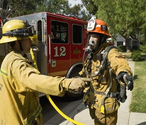 """It's imperative that fire departments establish an appropriate """"decon alley"""" as the gateway from the hazard area to rehab."""