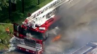 Houston ladder truck burns at warehouse fire