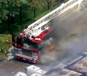 Ladder 28 ignited at the scene of a massive warehouse fire. (Photo/ABC13 screen shot)