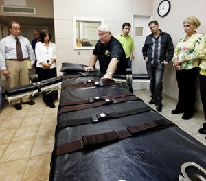 In this Sept. 18, 2009, file photo, Warden of the Louisiana State Penitentiary, Burl Cain, discusses the gurney used for lethal injections to Ruth Graham, far right and others as they visit the Louisiana State Penitentiary in Angola, La. (Photo/AP)