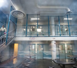 A corrections officer makes rounds in one of the pods of the Women's Jail in Lynwood on Dec. 18, 2017. Officials Tuesday began the process of overhauling the county's failing jail system.