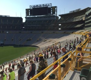 Climbers fan out during the 9/11 Memorial Stair Climb at Lambeau Field.