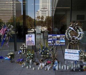 A memorial for slain police officer Juan Diaz is placed outside of Los Angeles Police Department headquarters Tuesday, Aug. 6, 2019, in Los Angeles. (AP Photo/Marcio Jose Sanchez)