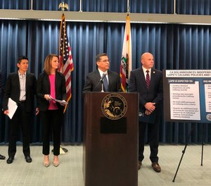 California Attorney General Xavier Becerra, second from right, announces an independent review of the Los Angeles Police Department's use of a gang member database after allegations of misuse on Monday, Feb. 10.