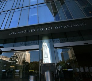 An investigation into allegations that members of the elite Los Angeles Police Department Metro Division falsified information has expanded to include 20 officers.