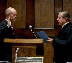 Kane County State's Attorney Joseph McMahon is sworn in by Judge Vincent Gaughan as the independent attorney to prosecute Chicago police Officer Jason Van Dyke during a hearing Thursday, Aug. 4, 2016 at the Leighton Criminal Courts Building in Chicago. (AP Photo/Chicago Tribune)