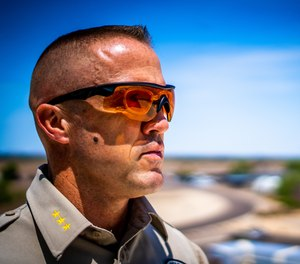 A law enforcement officer models the WX Rogue frame with a lens insert that offers protection from various laser wavelengths.