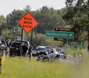 Two Mandeville police officers were shot after a vehicle chase, one fatally, near the U.S. 190 and Louisiana Highway 22 exit in Mandeville, La., Friday, Sept. 20, 2019. (David Grunfeld/The Advocate via AP)