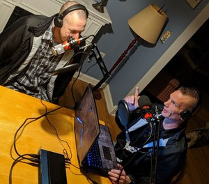Tim Galbraith (left) and Joe Davis record an episode of their new podcast