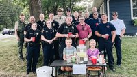Twins, 9, donate thousands to police fund after cops save their lemonade stand