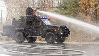 Lenco FireCat helps put out fire under threat of armed gunman