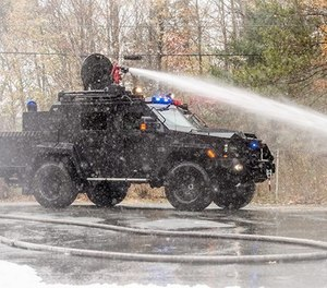 A BearCat X3– FireCat shoots water from a roof-mounted nozzle.