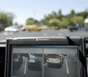 A police vehicle driven by San Diego County Deputy Sheriff Ben Chassen reads the license plates of cars in a parking lot Wednesday, Sept. 17, 2014, in San Marcos, Calif.
