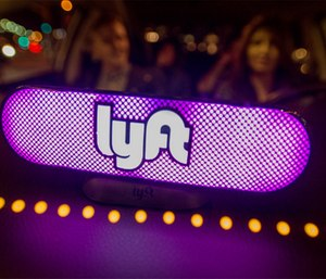 Lyft's new Amp glows on the dashboard of a car in San Francisco.