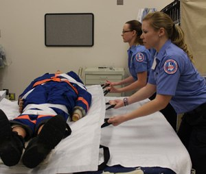 Four tips for safer lifting and moving of EMS patients. (Image/courtesy Bryan Fass)