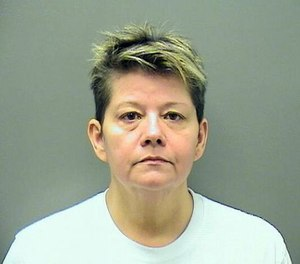 Paramedic Lisa Darlene Glaze is accused of cutting an $8,000 ring from the finger of a deceased patient and pawning it. (Photo/Hot Springs Police Department)