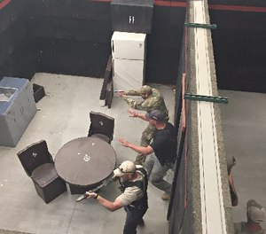 Student instructor controlling student officer's movements upon entering a room.