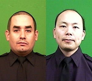 Officer Rafael Ramos (left) and Officer Wenjian Liu were shot and killed Saturday, Dec. 20, 2014, in the Brooklyn borough of New York.